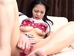 Asian perverted bitch is pinching on her nipples as that babe cums