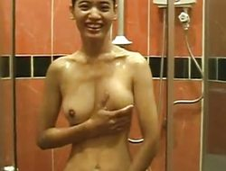 Asian babe in the shower rubbing on her soapy pussy