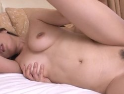 Busty Japanese honey gets spoon screwed in her bed