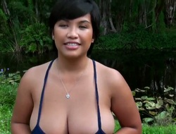 Glamorous asian with valuable natural large bra buddies and ass gives his boyfriend a valuable blowjob.