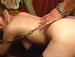 Aiko Nagai in latex puts schlong in chains, sucks and fuck