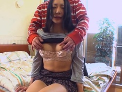 Concupiscent Asian licks her bra buddies during the time that fondling her curly pussy