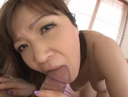 Breasty Oriental gives superb titty fuck and wet fellatio