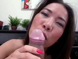 Pretty long haired oriental chick Lily with long hair and nice oral skills gives amazing blowjob to her client with very chubby cock in pov until her cums over her boobies.