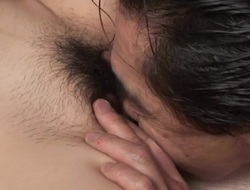 Hunk fingers Oriental hottie's hirsute twat until it's full of wetness