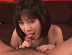 Sexy Japanese with large hooters plays with a sex toy